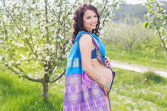 Pregnant woman is wearing blue sari Royalty Free Stock Photography