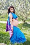 Pregnant woman is wearing blue sari Royalty Free Stock Image