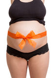 Pregnant woman wearing a bow on her belly Royalty Free Stock Photo