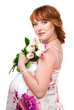 Pregnant woman wearing evening dress Royalty Free Stock Images