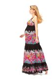 Pregnant woman wearing long dress Stock Image