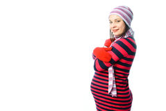 Pregnant woman wearing winter clothes Stock Photography