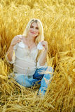 Pregnant woman  in wheat field Stock Image