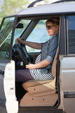Pregnant woman at the wheel of car Royalty Free Stock Photo