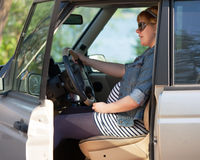 Pregnant woman at the wheel of car Royalty Free Stock Photography
