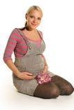 Pregnant woman on white Stock Photography