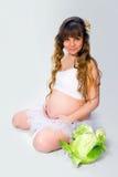 Pregnant woman on white background Royalty Free Stock Photos