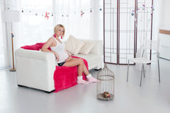 Pregnant woman in white interior Stock Images