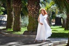 Pregnant woman white dress Stock Photo