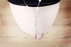 Pregnant woman with white necklace Royalty Free Stock Photo