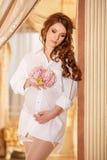Pregnant woman in white shirt Stock Photos