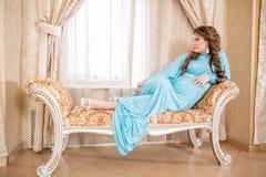 Pregnant woman in white shirt Royalty Free Stock Photo