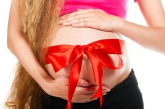 Pregnant woman white stomach hold bow 0121(62).jpg Royalty Free Stock Photo