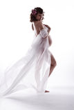 Pregnant woman in white waving flying dress. Royalty Free Stock Image