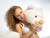 Pregnant woman whith teddy bear Royalty Free Stock Photos