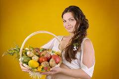 Pregnant woman with wicker basket harvest. looking at camera Stock Image