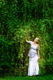 Pregnant woman in willow garden Royalty Free Stock Photos