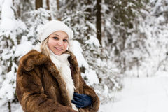 Pregnant woman in the winter forest Royalty Free Stock Images