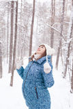 Pregnant woman in winter forest Stock Images