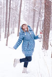 Pregnant woman in winter forest Royalty Free Stock Photos