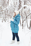 Pregnant woman in winter forest Royalty Free Stock Images
