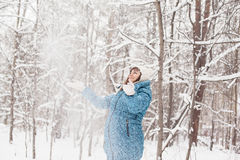 Pregnant woman in winter forest Royalty Free Stock Photo