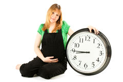 Pregnant Woman With A Clock Stock Images