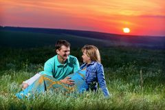 Pregnant woman. Pregnant women and a young men at sunset Stock Images