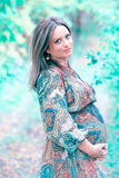 Pregnant woman in the woods Royalty Free Stock Photography