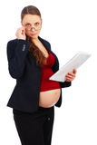 Pregnant woman at work... Royalty Free Stock Photo