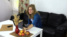 Pregnant woman work computer at home, eat red ripe apple stock video