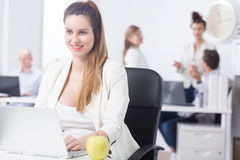Pregnant woman at work Royalty Free Stock Image