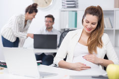 Pregnant woman at work Royalty Free Stock Photography