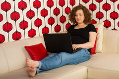Pregnant woman working home Stock Photos