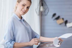 Pregnant woman working at home Stock Image