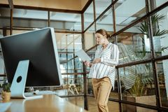 Pregnant woman working in the modern office of corporation. Office of corporation. Pregnant prosperous woman working in the modern office of corporation stock images