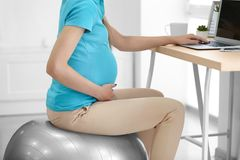 Pregnant woman working in office. Pregnant woman working in home office Royalty Free Stock Photos