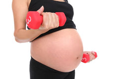 Pregnant Woman Working Out Stock Photo