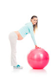 A pregnant woman working out with a fitness ball Stock Photo