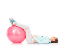 A pregnant woman working out with a fitness ball Royalty Free Stock Images