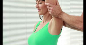 Pregnant woman working out with instructor stock video footage