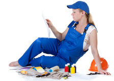 The pregnant woman in working overalls Royalty Free Stock Images