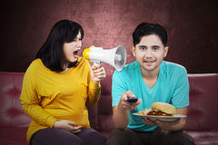 Pregnant woman yelling at her husband Stock Image