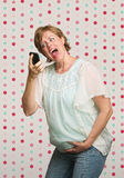 Pregnant Woman Yelling at Phone Royalty Free Stock Images