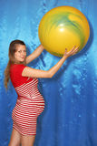 A pregnant woman and yellow ball Royalty Free Stock Image