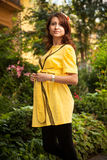 Pregnant woman in yellow clothes Stock Images