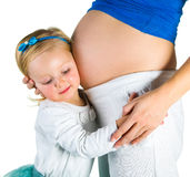 Pregnant woman with 2 yo daughter Royalty Free Stock Photography