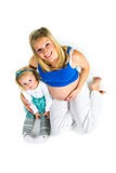 Pregnant woman with 2 yo daughter Stock Photography