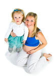 Pregnant woman with 2 yo daughter Royalty Free Stock Image