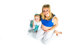 Pregnant woman with 2 yo daughter Royalty Free Stock Photos